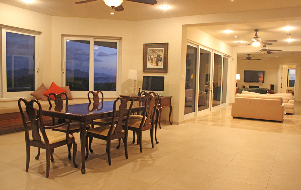 anguilla beaches villa dining room with built-in seating